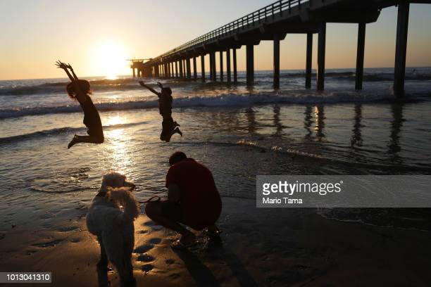 Kids play beneath Scripps Pier on the Pacific Ocean on August 7 2018 in San Diego California The sea surface temperature at Scripps Pier was measured...