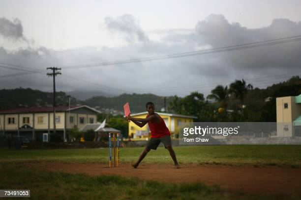 Kids play cricket on one of the many local pitches on March 4, 2007 in Kingston, Saint Vincent.
