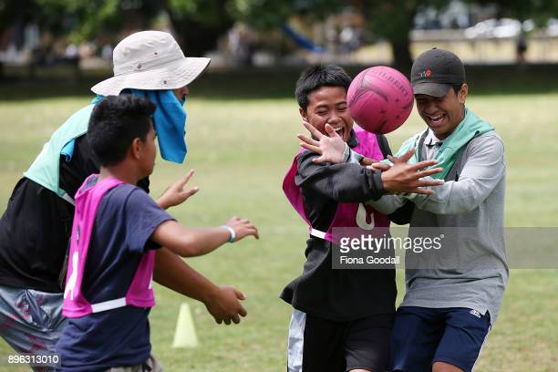 Kids play during the Queens Baton Relay at Victoria Park on December 21 2017 in Auckland New Zealand