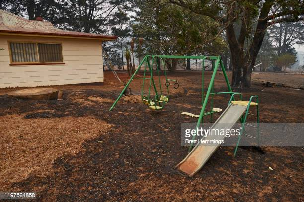 Kids play equipment remains intact as the ground surrounding it is scored by fire on January 5, 2020 in Wingello, Australia. One person has died...