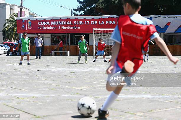 Kids play football at Plaza de Armas ahead of the FIFA U17 World Cup Chile 2015 on October 17 2015 in Chillan Chile