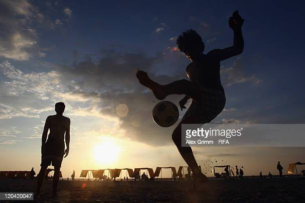 Kids play football at the beach during the FIFA U-20 World Cup 2011 on August 5, 2011 in Cartagena, Colombia.