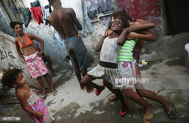 Kids play in a delapidated section of the occupied Complexo da Mare one of the largest favela complexes in Rio on October 10 2014 in Rio de Janeiro...