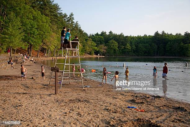 Kids play in famous Walden Pond State Reserve where Henry David Theroux wrote Walden Pond