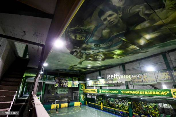 Kids play in the 5aside pitch of Sportivo Pereyra de Barracas club on June 13 2018 in Buenos Aires Argentina The mural was painted in the ceiling of...