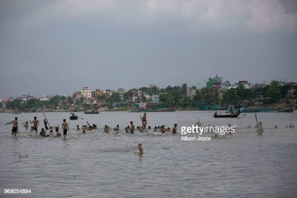 Kids play in the Buriganga river on June 3 2018 in Dhaka Bangladesh Bangladesh has been reportedly ranked 10th out of the top 20 plastic polluter in...