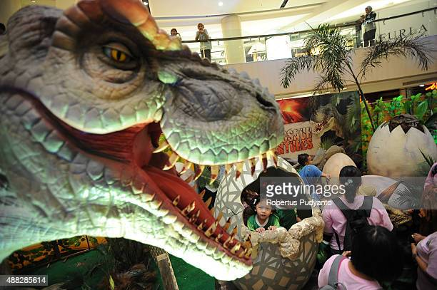 Kids play in the Dinosaur Adventure and Learning Experience Park at Tunjungan Plaza on September 15 2015 in Surabaya Indonesia The dinosaur park...