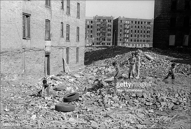 Kids play in the rubble of abandoned buildings in the South Bronx New York New York March 23 1979
