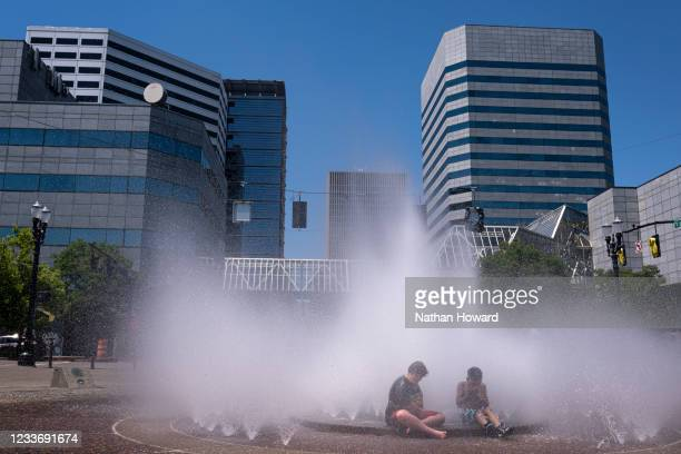 Kids play in the Salmon Springs Fountain on June 27, 2021 in Portland, Oregon. Record breaking temperatures lingered over the Northwest during a...