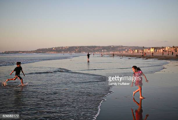 Kids play in the surf along Mission Beach in San Diego CA on Monday October 27 2014