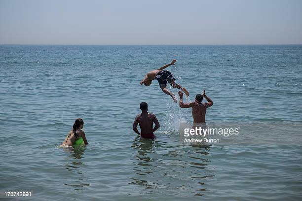 Kids play in the water at Rockaway Beach during a heat wave on July 17 2013 in the Rockaway Beach neighborhood of the Queens borough of New York City...