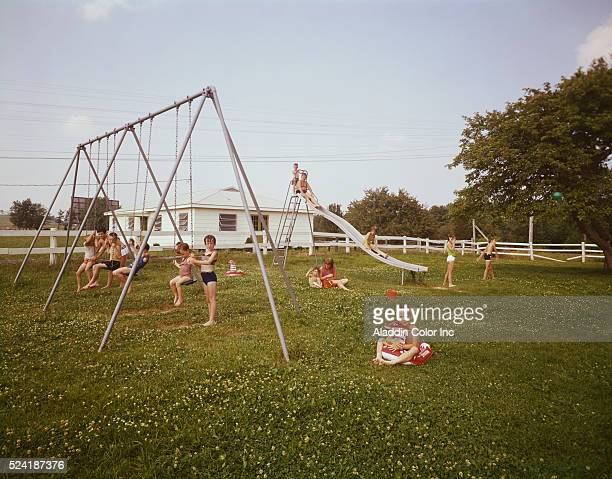 Kids play on a swingset on the grounds of Better Days Farm a vacation spot   Location Greenville New York USA