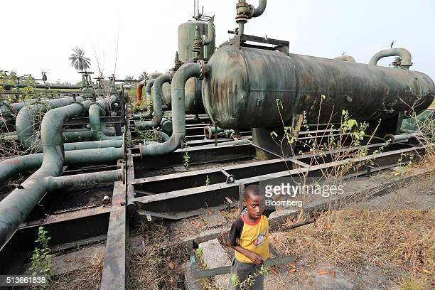 Kids play on broken pipework at an abandoned oil flow station operated by Royal Dutch Shell Plc in KDare Nigeria on Wednesday Jan 13 2016 Twenty...