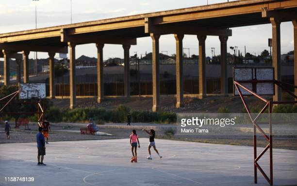 Kids play on the Mexican side of the USMexico border with the US visible in the background on June 27 in Ciudad Juarez Mexico The Mexican government...