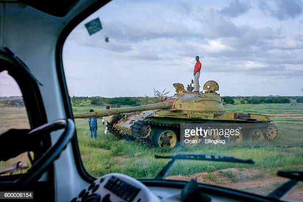 Kids play on top of a destroyed T72 battle tank outside the border town Iriba in Tchad The genocide in Darfur with its ethnic cleansing is also a...