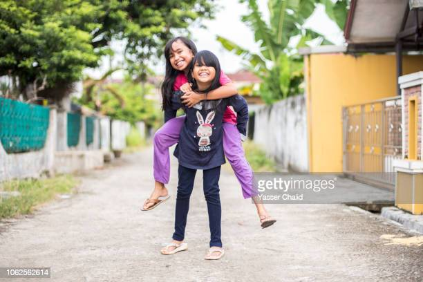 Kids Play Piggyback