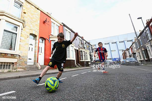 Kids play street football ahead of the Barclays Premier League match between Everton and Aston Villa at Goodison Park on October 18 2014 in Liverpool...
