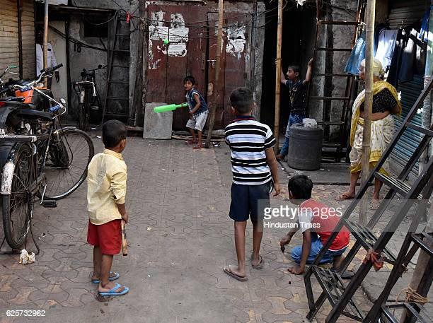 Kids play their last game of cricket Sane Guruji Nagar at Dhobi Ghat as people plan to vacate their houses for redevelopment on November 24 2016 in...