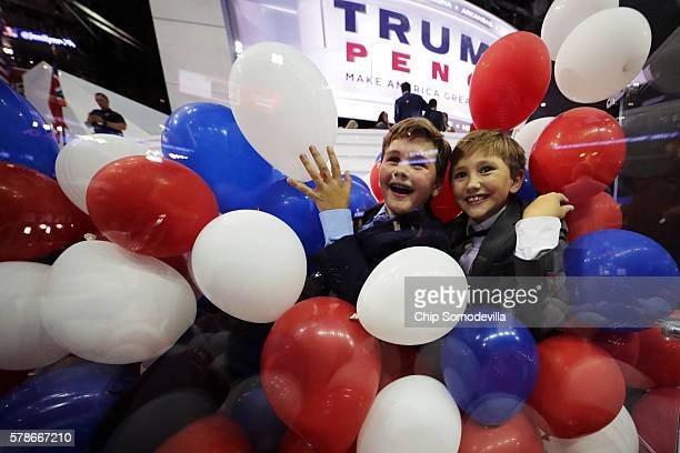 Kids play with balloons at the end of the fourth day of the Republican National Convention on July 21 2016 at the Quicken Loans Arena in Cleveland...