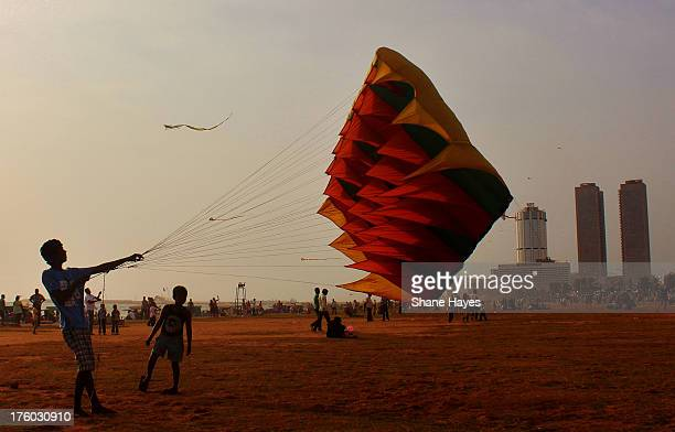 CONTENT] Kids play with kite's in the sun on Sunday in Colombo At the popular family fun and picnic spot in Colombo the famous Galle Face Green with...