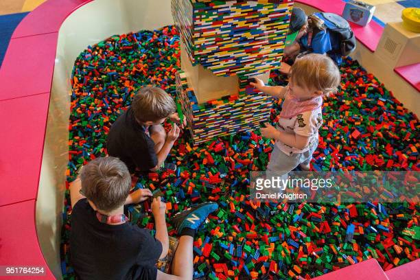 Kids play with LEGO building bricks at LEGOLAND Castle Hotel Grand Opening on April 26 2018 in Carlsbad California