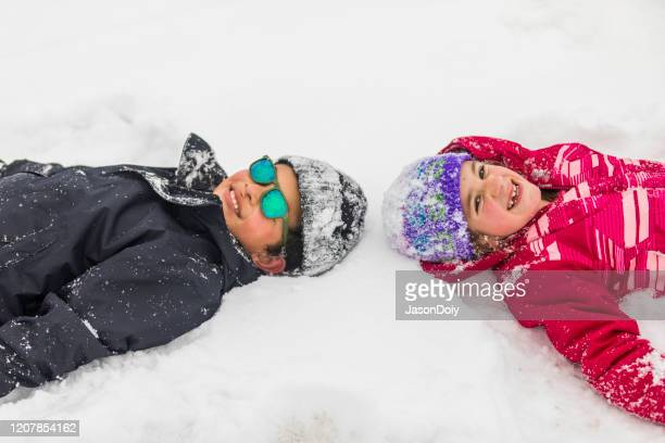 kids playing and having fun in the snow - winter sports event stock pictures, royalty-free photos & images