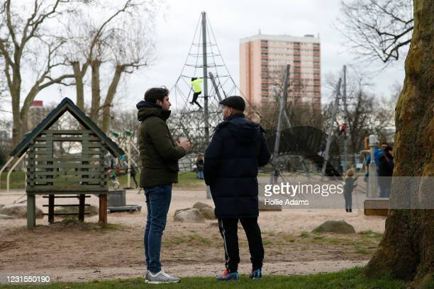 Kids playing as parents supervise at the Victoria Park playground on March 6, 2021 in London, England. Londoners are enjoying bright weather as end...