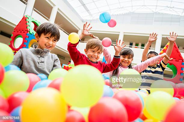 Kids playing at a ball pool