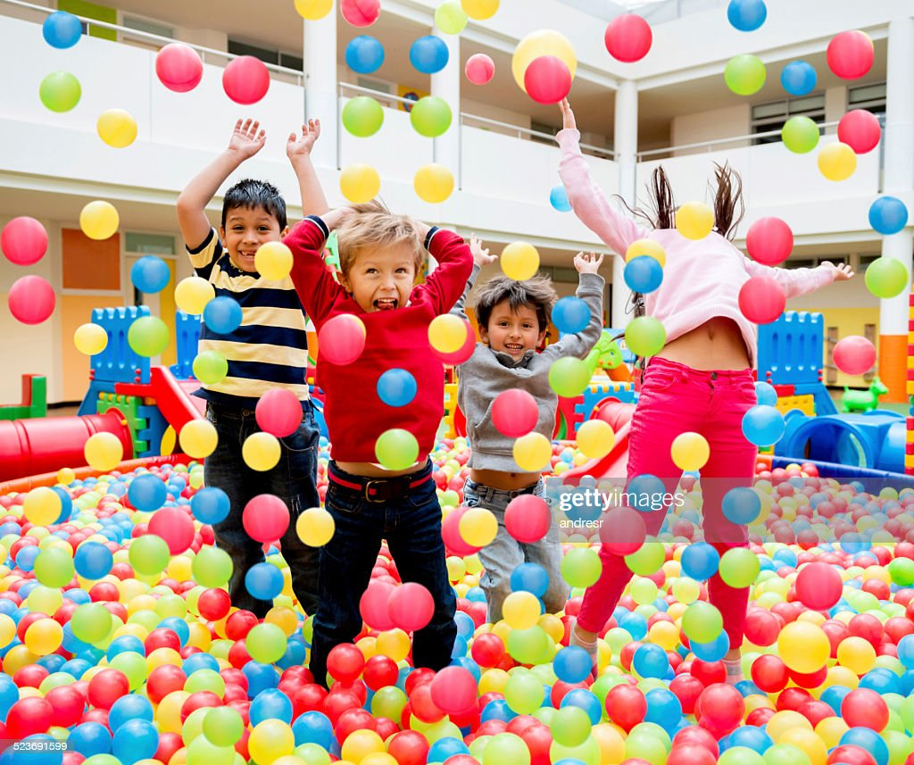 Kids playing at a ball pool : Stock Photo