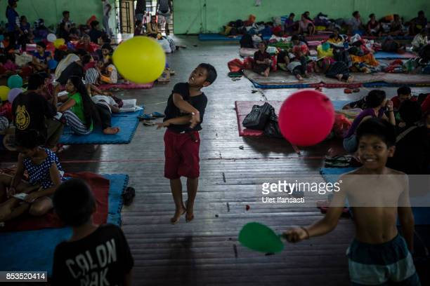 KLUNGKUNG BALI INDONESIA SEPTEMBER 25 Kids playing at evacuation center on September 25 2017 in Klungkung regency Island of Bali Indonesia Indonesian...