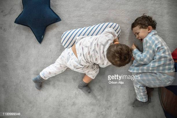 kids playing at home with a tent - sibling stock pictures, royalty-free photos & images