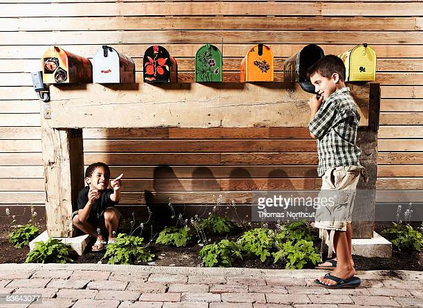 kids playing by mailboxes