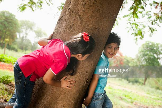 Kids (4-5) playing by trees