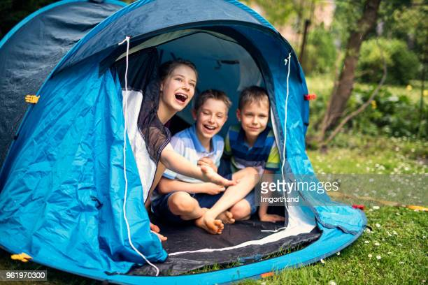kids playing camping in tent in garden - camping stock pictures, royalty-free photos & images