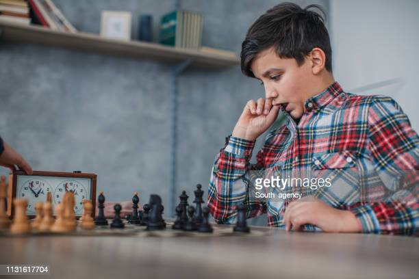 kids playing chess - south_agency stock pictures, royalty-free photos & images
