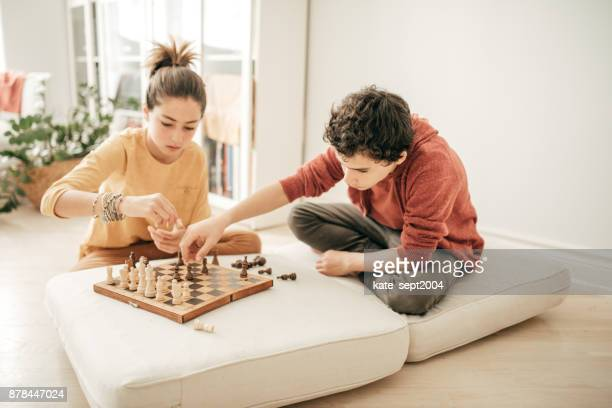 kids playing chess - game board stock photos and pictures