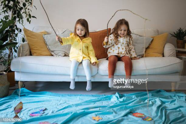 kids playing fishing at home - imagination stock pictures, royalty-free photos & images