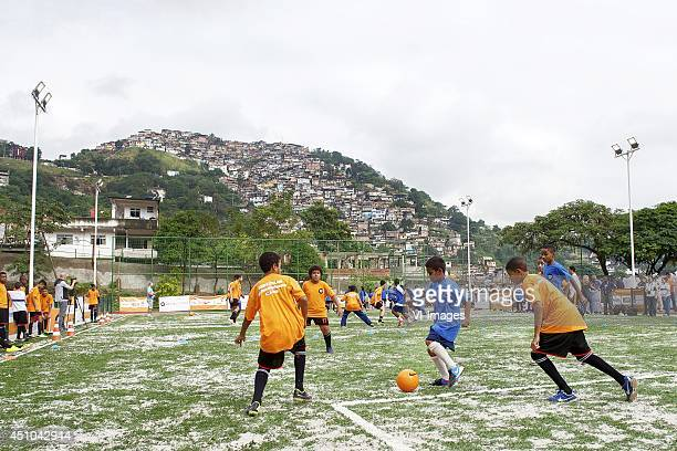 kids playing football at playground during the opening of a WorldCoaches football pitch on June 20 2014 in Rio de Janeiro Brazil
