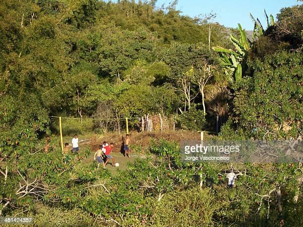 CONTENT] Kids playing football in a makeshift field near the village São Gonçalo do Rio das Pedras Minas Gerais Brazil