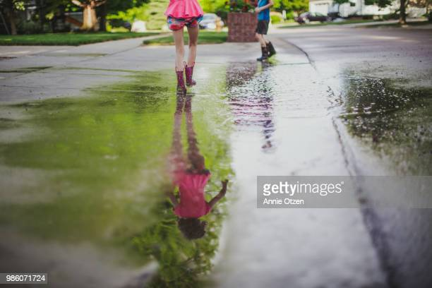 Kids Playing in a mud puddle