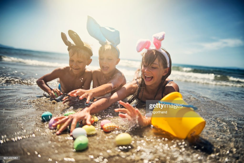 Kids playing in sea during summer Easter : Stock Photo