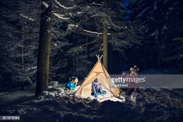 Kids playing in tent at night