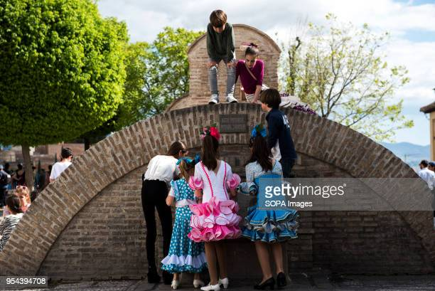 Kids playing in the fountain of Aljibe de San Nicolas during the Dia de las Cruces El día de la Cruz or Día de las Cruces is one of the most...