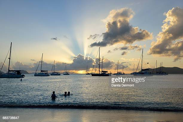 kids playing in water at cane garden bay, tortola, british virgin islands - cane garden bay stock pictures, royalty-free photos & images