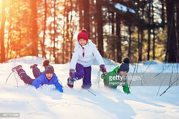 Kids playing in winter forest