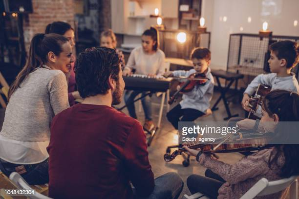 kids playing instruments in music school - rehearsal stock pictures, royalty-free photos & images