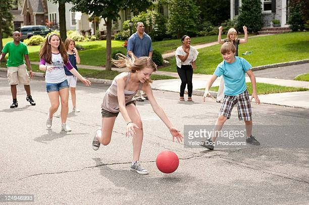 Kids Playing kickball in a Suburban Neighborhood