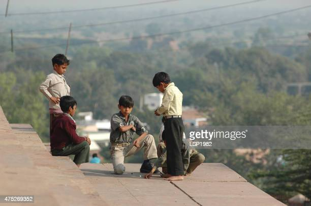 Kids playing Marbles outdoor, India.