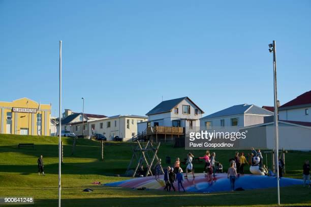 Kids playing on a playground in Vestmannaeyjar (Heimaey town), Heimaey Island, Iceland