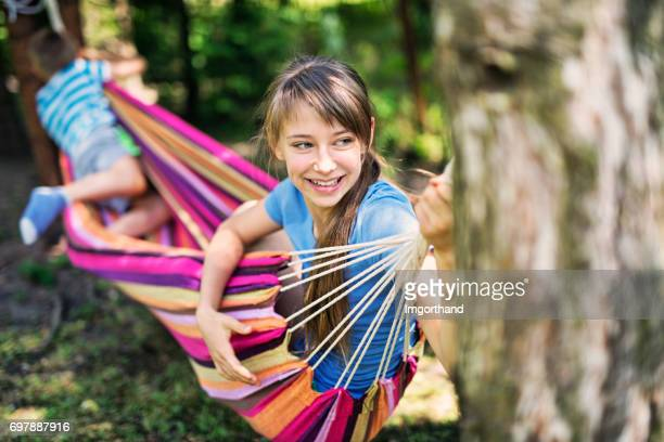 kids playing on hammock in the back yard - lazy poland stock photos and pictures